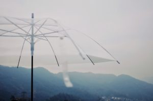 clear umbrella in mountains